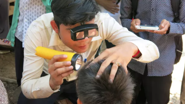 Eyes are checked for signs of trachoma in Cambodia. Photo courtesy of USAID