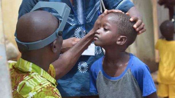 A young boy's eyes are examined for signs of trachoma during a Tropical Data Training in Senegal. Photo by: Shea Flynn / RTI International