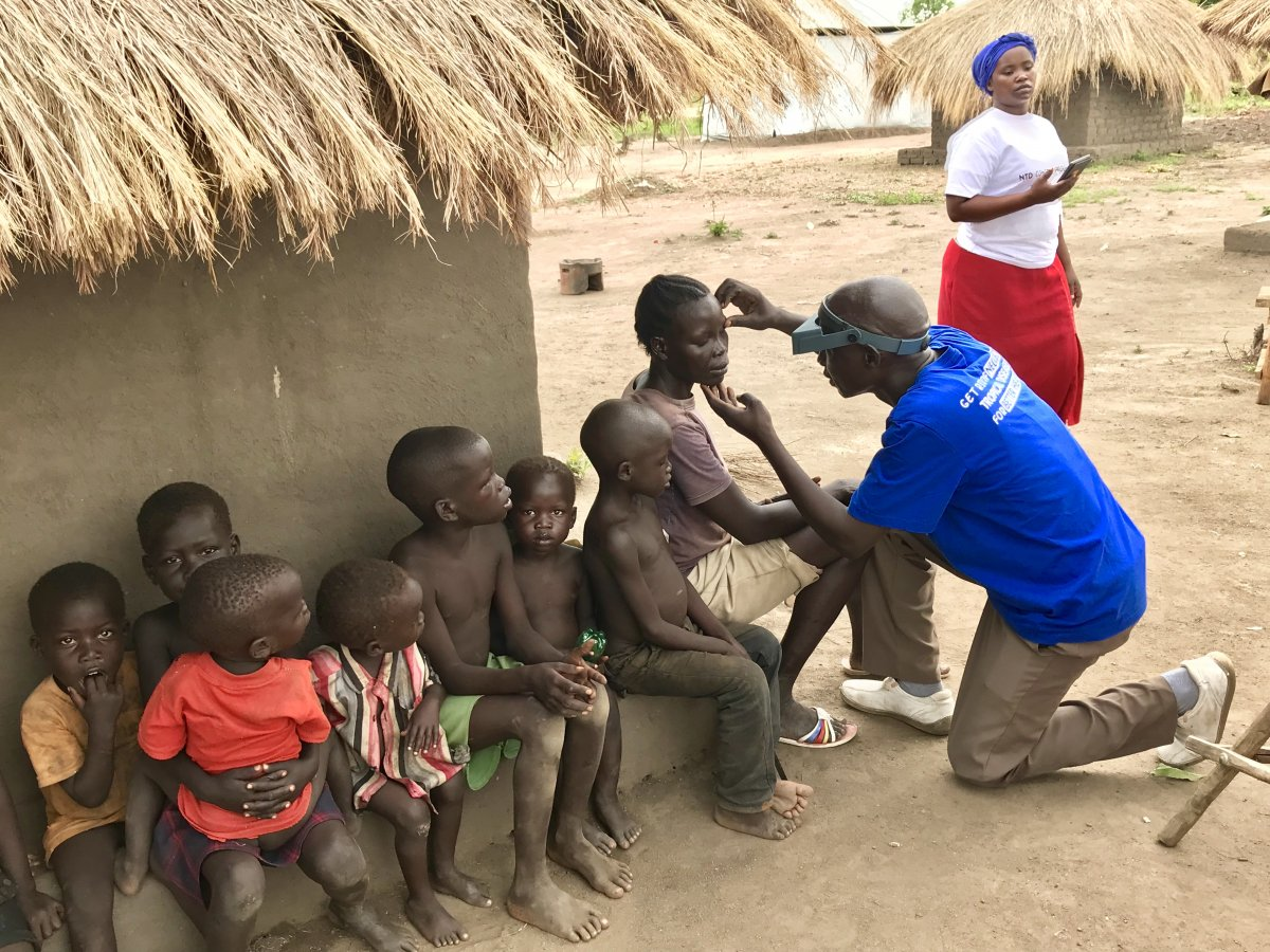 Members of a household wait to have their eyes checked by William Azabo, Trachoma Grader, for clinical signs of trachoma in Imvepi Refugee Settlement in Arua District, northwestern Uganda.  Photo courtesy of USAID, Carly Smith