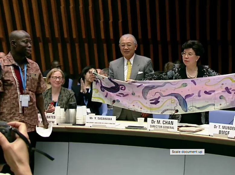 Dr Margaret Chan receiving a symbolic NTD scarf for her contribution to the eliminations of NTDs